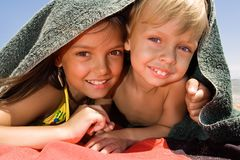 Little brother and sister playing hide-and-seek. Small children playing hide-and-seek at the beach Stock Photography