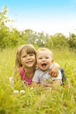 Little brother and sister playing on the nature Stock Photography