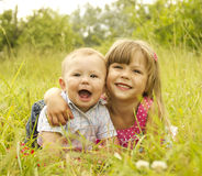 Little brother and sister playing on the nature Royalty Free Stock Image