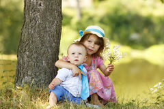 Little brother and sister playing on the nature Royalty Free Stock Photography