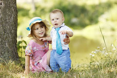 Little brother and sister playing on the nature Royalty Free Stock Images