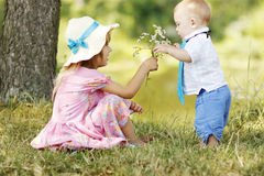 Little brother and sister playing on the nature Royalty Free Stock Photos