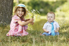 Little brother and sister playing on the nature Royalty Free Stock Photo