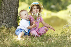 Little brother and sister playing on the nature Stock Photos