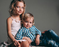 Little brother and sister playing together in a room Royalty Free Stock Image