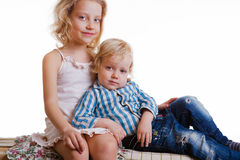 Little brother and sister playing together in a room Royalty Free Stock Images