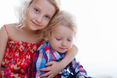Little brother and sister playing together in a room Royalty Free Stock Photo