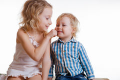 Little brother and sister playing together in a room Royalty Free Stock Photos