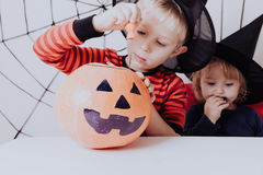 Little brother and sister preparing halloween party Royalty Free Stock Image