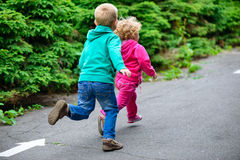Little brother and sister running Royalty Free Stock Photography