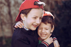 Little brothers in cap Stock Photos