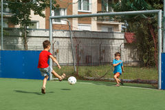 Little brothers playing soccer Royalty Free Stock Images