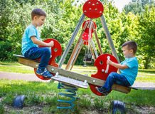 Little brothers on seesaw Stock Photos