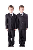Little brothers twins in business suits isolated on white Royalty Free Stock Photos