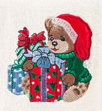Little brown bear with christmas hat and gift boxes Royalty Free Stock Photos