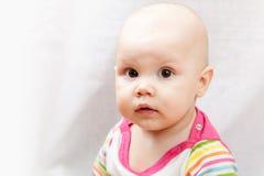 Little brown eyed Caucasian baby girl Stock Image