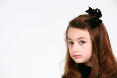 Little brunette with bow Stock Photos