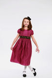Little brunette girl curtsey Royalty Free Stock Photography