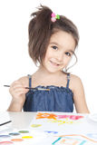 Little brunette girl drawing at the desk Royalty Free Stock Photo