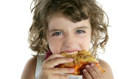 Little  brunette girl  eating pizza Royalty Free Stock Image