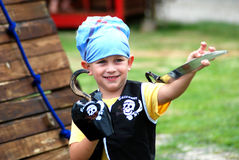 Little buccaneer boy. A cute little caucasian white boy child with happy smiling facial expression dressed like a buccaneer and playing on the playground Stock Images