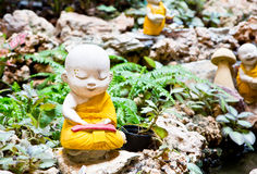 Little Buddha. Rock in Chinese Temple royalty free stock photography