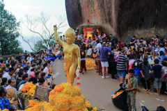 Little buddha statue in crowd of people Stock Photography