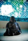 Little Buddha Statue in the Window Stock Images