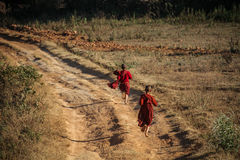 Little buddhist running in the the shan hills between Kalaw and Inle Lake, Burma Royalty Free Stock Image