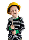 Little builder boy. Funny little boy in yellow helmet playing with hammer Stock Images