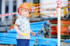 Little builder in hardhats with hammer working outdoors Royalty Free Stock Photo