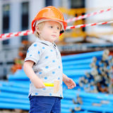 Little builder in hardhats with hammer working outdoors Royalty Free Stock Photography