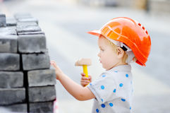 Little builder in hardhats working outdoors Royalty Free Stock Photography