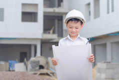 Little builder in helmet thinking Royalty Free Stock Image