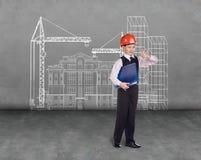 Little builder in helmet Royalty Free Stock Image