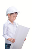Little builder in helmet thinking. Royalty Free Stock Photography