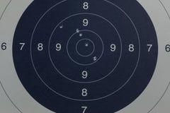 Bullet holes in the black target. Little bullet holes in the black target stock images