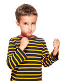 Little bully boy with black eye. In fighting stance isolated on white royalty free stock photos