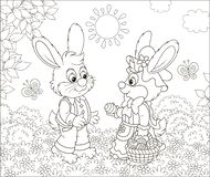 Little Bunnies with a decorated Easter basket stock illustration