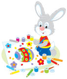 Little Bunny draws an Easter card Stock Photography