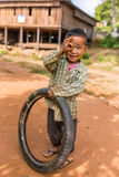 Little burmese boy playing with the bike tyre in the village near Hsipaw, Myanmar Burma Stock Images