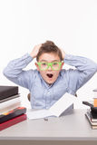 Little business boy screaming. Shouting and keeping his head with both hands. Little man in glasses posing with opened mouth Stock Image