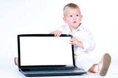 Little business boy in  solid white suit sitting at notebook. Stock Image