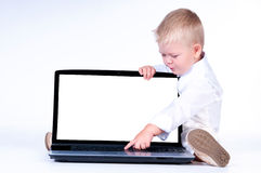 Little business boy in  solid white suit sitting at notebook. Royalty Free Stock Photos