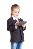 Little business girl with a tablet Royalty Free Stock Photo