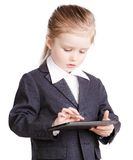 Little business girl with a tablet Royalty Free Stock Photos