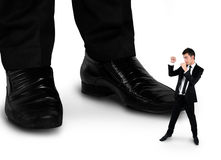 Little business man fighting with boss Stock Images