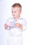 Little business man with money Stock Images