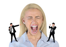 Little business man screaming on stressed woman Stock Photo