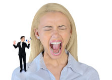 Little business man screaming on woman Royalty Free Stock Photos